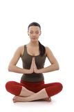 Young woman meditating in prayer position Royalty Free Stock Images