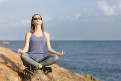 Young woman meditating Royalty Free Stock Images
