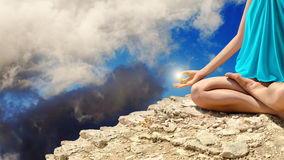Young woman meditating on the rocks Royalty Free Stock Photos