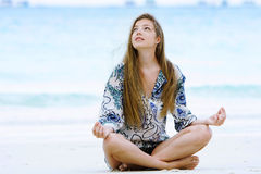 Young woman meditating on sea background Royalty Free Stock Photo