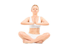 Young woman meditating seated on the floor Stock Photography