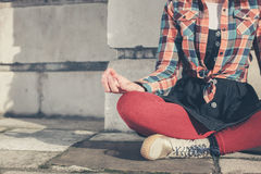 Young woman meditating in the street Royalty Free Stock Image