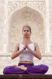 Young woman  meditating at Taj Mahal Stock Photos