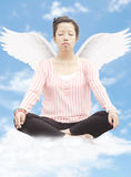 Young woman meditating with wings Stock Photos