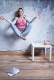 Young woman meditating. Meditating young women levitating above ground Royalty Free Stock Photos