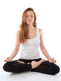 Young woman meditating in yoga pose of lotus Royalty Free Stock Image