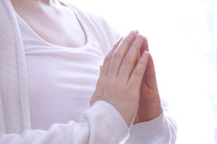 Young woman meditating in yoga pose. Spiritual woman's hands in a praying yoga style position meditating stock photos