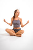 Young woman meditating in yoga position Stock Photography