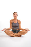 Young woman meditating in yoga position Stock Photos