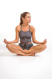 Young woman meditating in yoga position Royalty Free Stock Photos