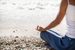 Young woman meditation on the beach. Young blonde woman meditation on the beach Royalty Free Stock Photo