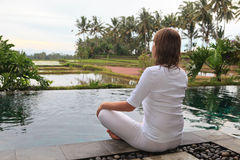 Young woman meditation outdoors Stock Photos