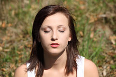 Young woman during meditation in park Royalty Free Stock Photo