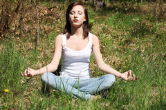 Young woman during meditation in park Royalty Free Stock Image