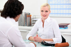 Young woman meeting employer Stock Image