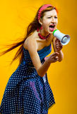 Young woman with megaphone. Young woman shouting through megaphone Stock Images