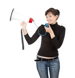 Young woman with megaphone looking at the camera Royalty Free Stock Image