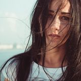 Young woman with mess black long hair portrait close up Stock Images