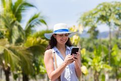 Young Woman Messaging With Cell Smart Phone Over Tropical Forest And Blue Sky Beautiful Brunette Girl Chatting Online Stock Photos