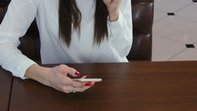 Young woman messaging on the phone and drinking coffee or tea stock video