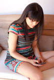 Young woman messaging with a smartphone Royalty Free Stock Images