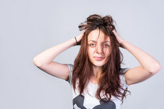 Young woman with messy tousled hair Royalty Free Stock Photography