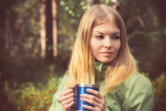 Young Woman with metal touristic tea cup Outdoor Stock Images