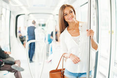 Young woman in metro. Beautiful young woman in metro stock photos