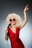 Young woman with mic Stock Photography