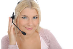 Young woman with microphone and computer. Having online conversation throw internet. help desk assistant Royalty Free Stock Images