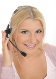 Young woman with microphone and computer. Having online conversation throw internet. help desk assistant Stock Photo