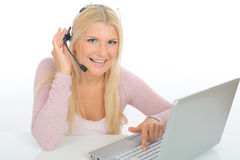 Young woman with microphone and computer Stock Photos