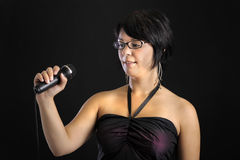 Young woman with microphone holding a speech Royalty Free Stock Photo