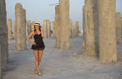 Young woman in a middle of concrete pilings Stock Images