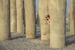 Young woman in a middle of concrete pilings Royalty Free Stock Image