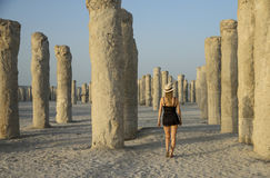Young woman in a middle of concrete pilings Royalty Free Stock Photography
