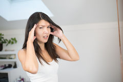Young woman with a migraine headache Stock Image
