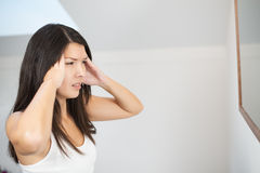 Young woman with a migraine headache Royalty Free Stock Photography