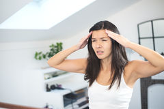Young woman with a migraine headache Stock Images