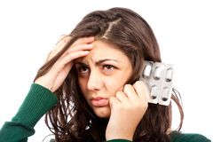 Young woman with migraine, holding pills Royalty Free Stock Photo