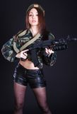 Young woman in the military uniform with the assault rifle Royalty Free Stock Photography