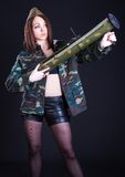 Young woman in the military uniform with the bazooka Stock Image