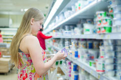 Young woman in milk products department Stock Photography
