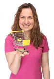 Young woman with mini shopping cart Stock Photography
