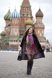 Young woman in a mink coat on the Red Square in Moscow Stock Images