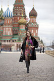 Young woman in a mink coat on the Red Square in Moscow Stock Photography