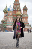 Young woman in a mink coat on the Red Square in Moscow Stock Photos