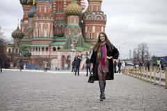 Young woman in a mink coat on the Red Square in Moscow Stock Photo