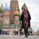 Young woman in a mink coat on the Red Square in Moscow Royalty Free Stock Photo