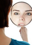 Young woman with a mirror. White background Royalty Free Stock Photo